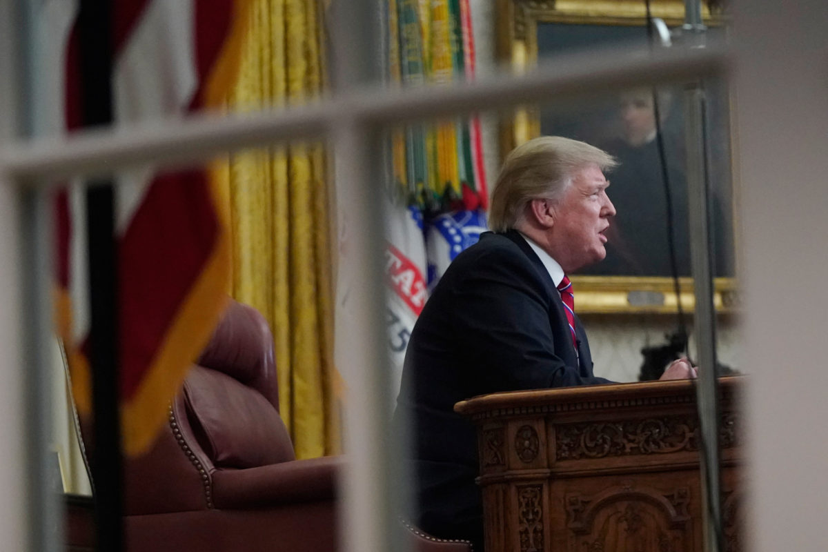 President Donald Trump delivers a televised address to the nation from his desk in the Oval Office at the White House in Washington