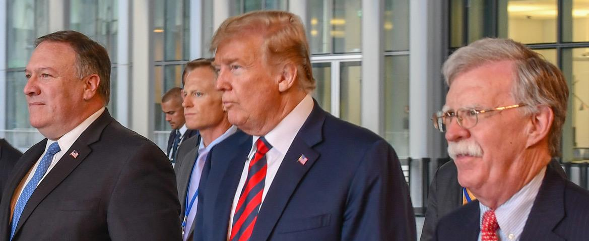 Mike_Pompeo_and_Donald_Trump_walking_with_John_R._Bolton_in_Belgium,_July_2018,_from-_Secretary_Pompeo_Participates_in_Press_Conference_With_President_Trump_at_NATO_(41551661440)_(cropped)